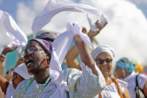Salvador, Brazil. Worshippers from the Candomble religion pray to Yemanjá, the sea goddess of ancient Yoruba mythology and one of the most popular deities of Afro-Brazilian culture, during the celebration of Yemanjá's day at the Rio Vermelho beach