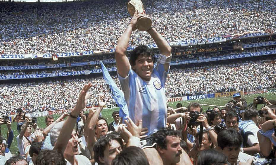 Diego Maradona holds up his team's trophy after Argentina's 3-2 victory over West Germany at the 1986 World Cup final in Mexico City