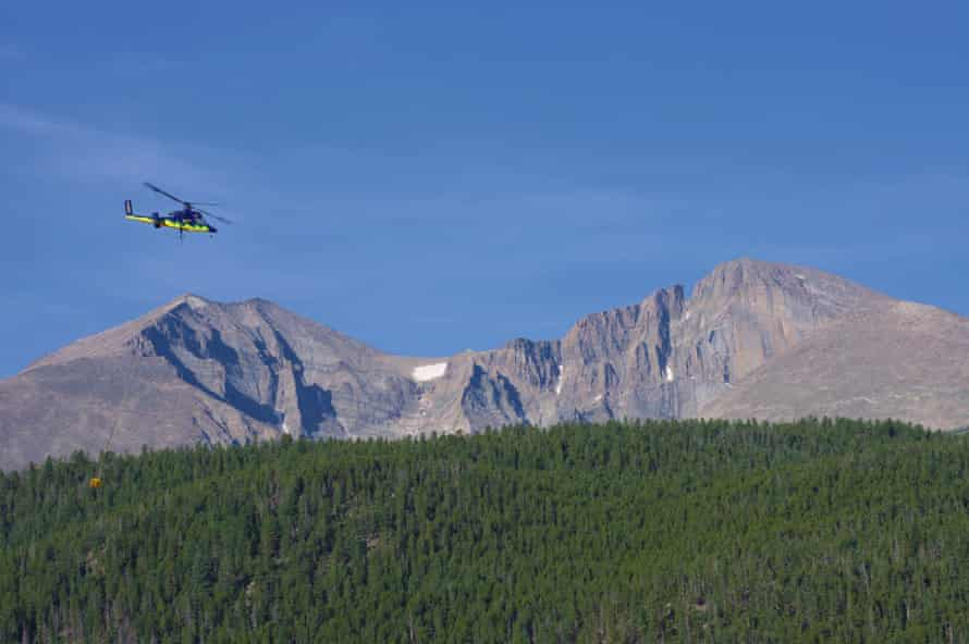 A helicopter delivers parts for new toilets installed near Longs Peak in Rocky Mountain national park, in 2018.