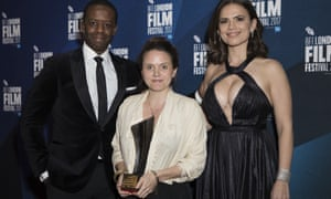 Grierson award winner Lucy Cohen flanked by actors Adrian Lester and Hayley Atwell.