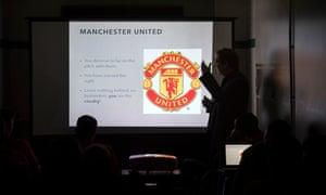 A sports psychologist addresses Yeovil's players.