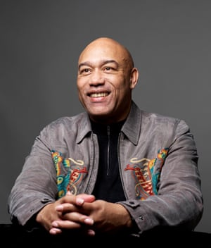 Gus Casely-Hayford smiling, hands crossed