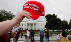 Baseball cap featuring Donald Trump's campaign slogan Make America Great Again pictured in front of the White House