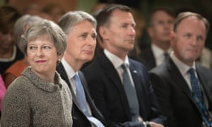 The prime minister, Theresa May (left), sits alongside the chancellor, Philip Hammond, the health secretary, Jeremy Hunt and NHS boss, Simon Stevens (right) at the Royal Free hospital