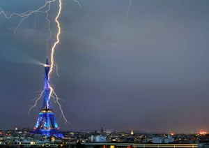 This picture, by amateur photographer Bertrand Kulik, a concert violinist, of a lightning bolt appearing to strike the Eiffel Tower is included in an exhibition of images of lightning strikes across France being held in Issy l'Évêque in Burgundy.