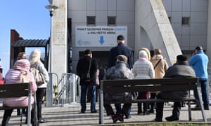 People queue to the entrance of the vaccination point at the Netto Arena in Szczecin, northwestern Poland, 29 March 2021.