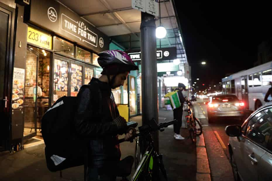 Food couriers on King Street Newtown.