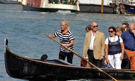 Giorgia Boscolo brings passengers to the other side of the Canal Grande in a traghetto gondola in Venice.