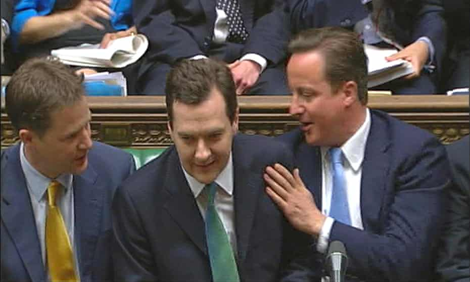 Clegg and Cameron congratulate Osborne on his budget in June 2010