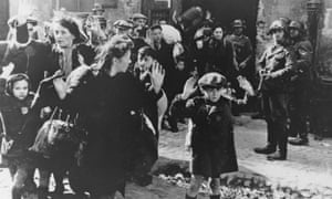 Jewish Poles surrender to German soldiers after the collapse of resistance in the Warsaw Ghetto.