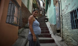 Rosa Salazar, 36, who is five months pregnant, stands in an alley of the Petare slum, east of Caracas, on 3 February. Officially Venezuela has about 4,700 cases of Zika, which may be linked to birth defects, but the real figure may be as high as 400,000.
