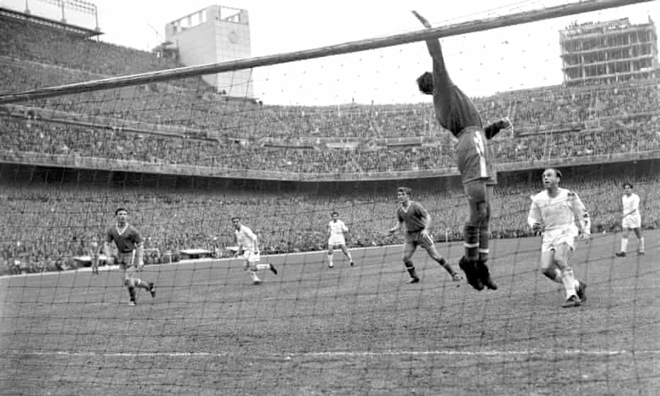 Manchester United goalkeeper Ray Wood throws the ball over the crossbar, watched by Real Madrid's Alfredo Di Stefano, during the second leg of the 1957 European Cup semi-final.