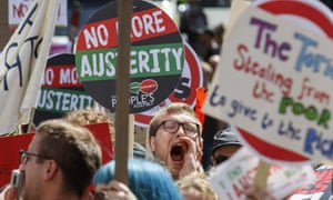 Protesters carrying anti-austerity placards and banners are pictured taking part in an anti-austerity march and demonstration in Bristol last month.