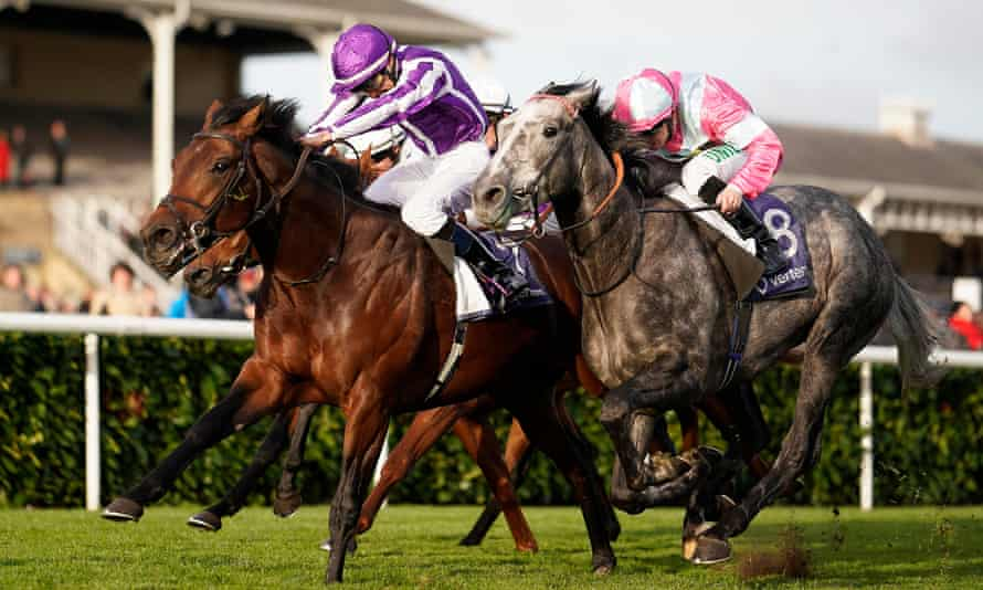 Donnacha O'Brien (purple cap) and Magna Grecia on their way to victory in the Vertem Futurity Trophy Stakes at Doncaster ahead of Phoenix Of Spain (right)