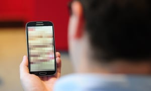 man holding blurred out phone