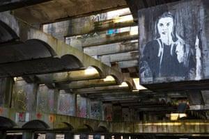 Graffiti adorns the concrete through the shell.