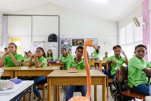 Flamingo Bob accompanies Odette on a school visit in Curaçao.
