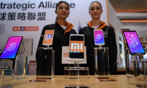 Mobile phones are displayed at a joint press conference by Xiaomi and Hutchison to announce the partnership with Three.