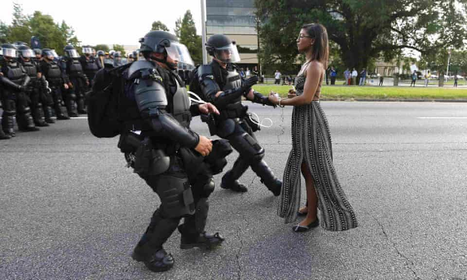 A demonstrator protesting the shooting death of Alton Sterling is detained by law enforcement in Baton Rouge in 2016.