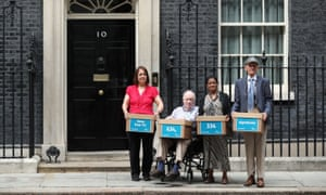 Representatives from Age UK deliver a petition to 10 Downing Street calling for free TV for the over-75s to be saved