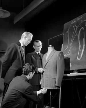 Trainee Burton tailors practise fitting a suit, Guisborough, 1960.