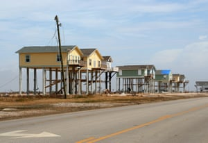 Elevated houses along Highway 87, Bolivar Peninsula, Texas.