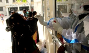 A woman is tested for coronavirus in Delhi.