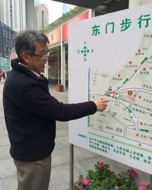 Leo Houng inspects a map of Shenzhen