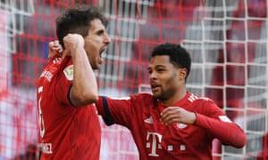 Bayern Munich's Javi Martínez celebrates his goal with Serge Gnabry.