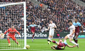 Robert Snodgrass of West Ham United slides for the ball but can't steer it into the net.
