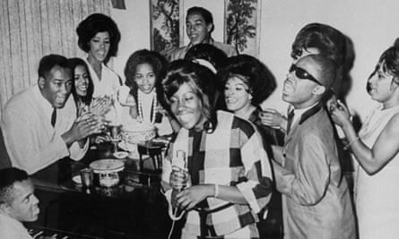 Berry Gordy playing the piano as Motown players including Smokey Robinson (rear) and Stevie Wonder (second fron right) sing together at the label's studio.