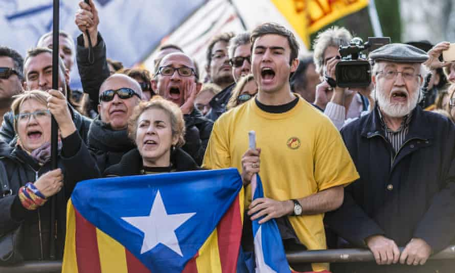 Pro-independence activists demonstrate at the Catalan parliament as Carles Puigdemont, mayor of Girona, was chosen as regional president.