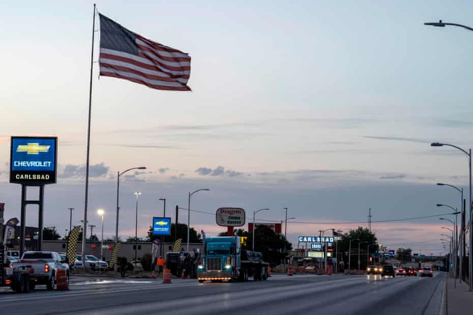 A semi-truck drives down one of the major streets in Carlsbad, New Mexico. Once a mining town, Carlsbad has seen a boom in oil and gas extraction, but the pandemic and a related demand for oil over the last year hit workers hard.