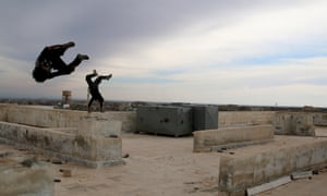 Parkour coach Ibrahim al-Kadiri, 19, demonstrates his Parkour skills with his friend in the rebel-held city of Inkhil, west of Deraa, Syria, February 4, 2017