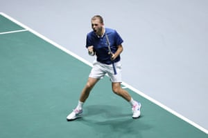 Dan Evans celebrates on his way to taking the first set.