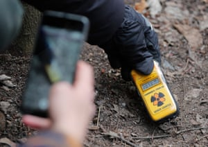 Using a Geiger counter to measure radiation levels in Kopachi