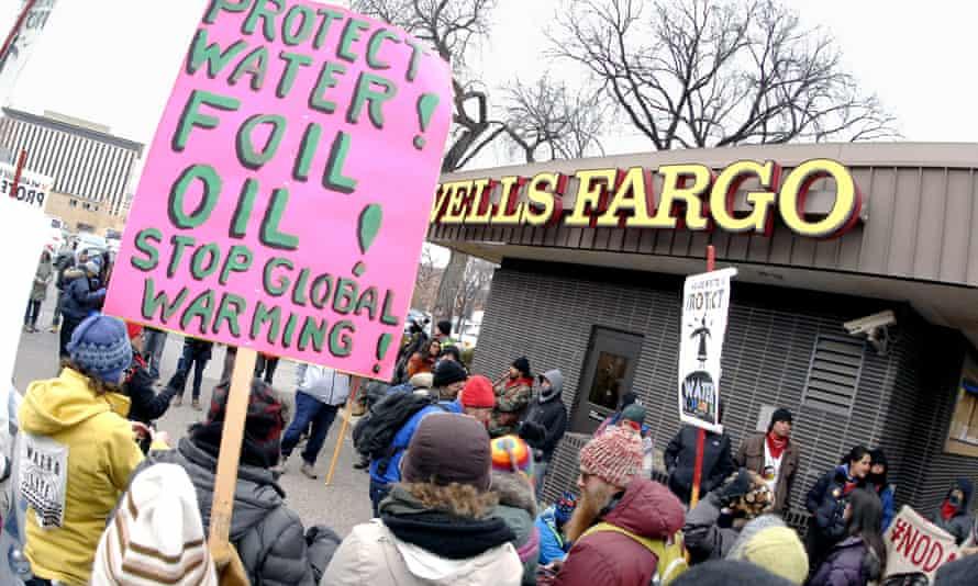 Dakota access pipeline protesters demonstrate outside a Wells Fargo bank branch in Bismarck, North Dakota