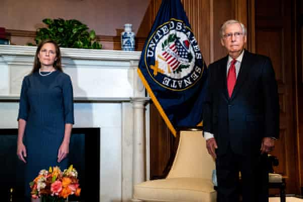 Judge Amy Coney Barrett attends a meeting with Mitch McConnell at the US Capitol in preparation for her confirmation hearing.