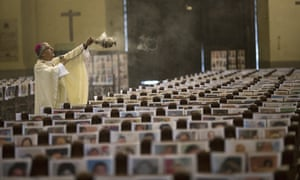 The archbishop of Lima, Carlos Castillo, blesses portraits of Covid-19 victims at his cathedral in the Peruvian capital.