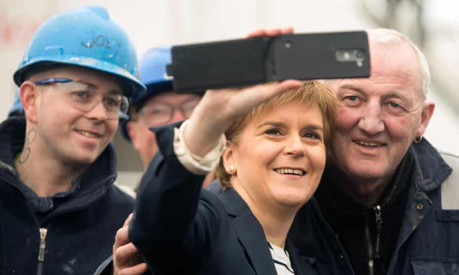 Nicola Sturgeon takes a selfie with workers during her visit to Ferguson shipyard in Port Glasgow while on the Scottish election campaign trail.