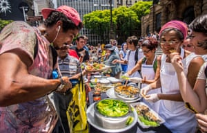 Farmers, food security activists and chefs prepare a banquet in downtown São Paulo, Brazil in protest at Doria's farinata proposal.
