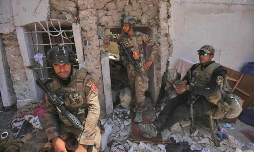 Members of the Iraqi anti-terrorism forces advance in the old city of Mosul.