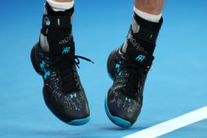Murray's hip injury has put him on the brink of retirement, but it's his ankle supports that catch the photographers' attention