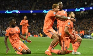 The Lyon players rush to celebrate Lyon's decisive second goal against Manchester City with the scorer Nabil Fekir, who almost joined Liverpool in the summer.