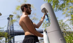 A man refills his water bottle as temperatures reach the mid-to-upper 90s in Williamsburg section of Brooklyn.