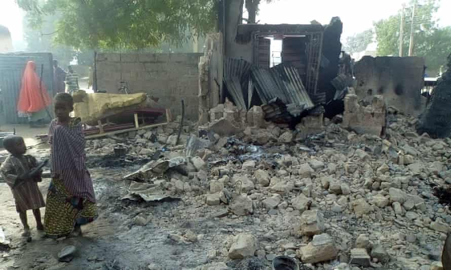 Children stand near the rubble of a burnt house after Boko Haram attacks at Dalori village on the outskirts of Maiduguri.