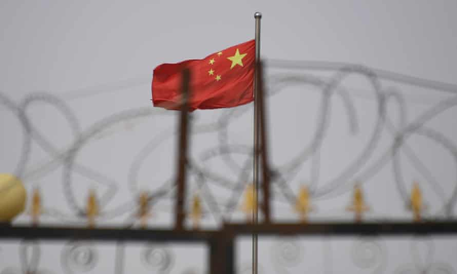 Chinese flag and barbed wire