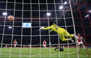 Cristiano Ronaldo of Juventus scores his team's first goal past Andre Onana of Ajax .