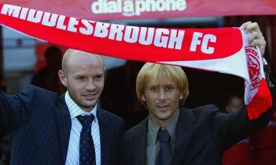 Middlesbrough's new signings Danny Mills and Gaizka Mendieta hold up a scarf in August 2003.