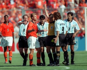 Netherlands are down to 10 men as Arthur Numan is given his marching orders.